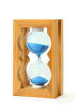 Sand falls into wooden hourglass Stock Images