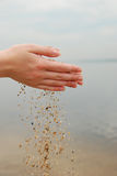 Sand in female hands Royalty Free Stock Images