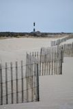 Sand Fence with Fire Island Lighthouse in the distance Stock Photography