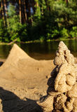 Sand figures. On the bank of river Stock Images