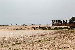 Sand filling of a local beach in Lekki, Lagos Nigeria. Sand filling of a local beach in Lekki Lagos Nigeria. The fresh sand is white while the old beach has a royalty free stock image