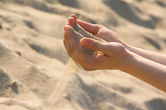 Sand through fingers Stock Image