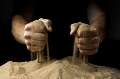 Sand fist. On a black background Royalty Free Stock Photography