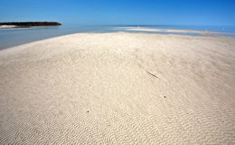 Sand flats along shore of Lake Winnipeg Stock Image