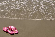 In the Sand - Flip Flops Stock Photography