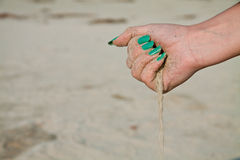 Sand flowing from a hand Royalty Free Stock Images