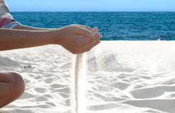Sand flowing through the hands. Stock Photo