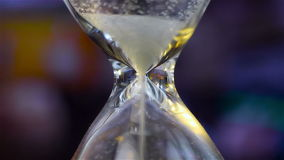 Sand Flowing Through An Hourglass stock video footage