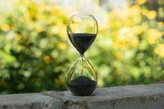 Sand clock in the garden royalty free stock photos
