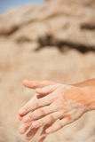 Sand flows through the female hands Stock Photo