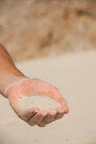 Sand flows through the female hands Royalty Free Stock Photography