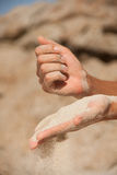 Sand flows through the female hands Stock Photos