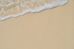 Sand and foam Stock Image