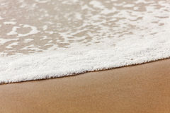Sand and foam at Virginia Beach Royalty Free Stock Photos
