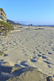 Sand foot-prints in Cannon beach Oregon. Stock Image