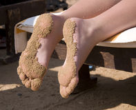 Sand   on foot young girl Stock Photography