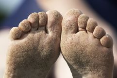 Sand on the foots Royalty Free Stock Photo