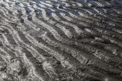 Sand formations. Beautiful sand formations have emerged at sea Royalty Free Stock Photo