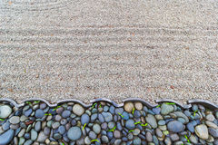 Sand Garden with Pebble Stones Border Royalty Free Stock Images