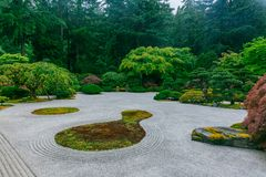 Sand garden among trees at Portland Japanese Garden, Portland, USA. View of sand garden among trees at Portland Japanese Garden, Portland, USA stock photography
