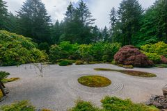 Sand garden among trees at Portland Japanese Garden, Portland, USA. View of sand garden among trees at Portland Japanese Garden, Portland, USA royalty free stock image