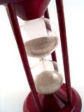 Sand glass. Red wooden sand glass Stock Photos