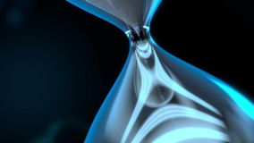 Sand glass. The sand glass flows in a big space,it flows cyan sand that suggests that the technology changes over time