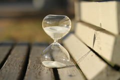 Sand-glass. Modern hourglass on a bench in a park Stock Images