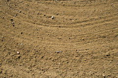 Sand in golf bunker. Sand with rake patterns in a golf course bunker Stock Images