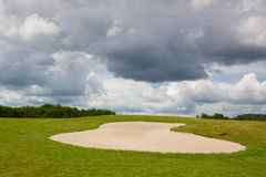 Sand golf bunker on a empty golf course before rain Stock Image