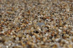 Sand grains closeup with focus on the center and blurred background. royalty free stock images