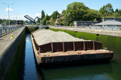 Sand and gravel barge in locks Royalty Free Stock Photography
