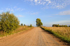 Sand-and-gravel country road Royalty Free Stock Image