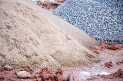 Sand and gravel on floor. Sand and gravel on wet floor at construction site in rainy day royalty free stock photo