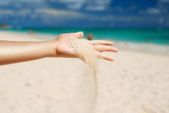 Sand in hand Stock Photo