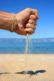 Sand-hand hand-sand. Hand with the sand at the beach Stock Photo
