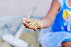 Sand on hand. Stock Images