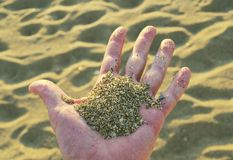 Sand in the hand Stock Images