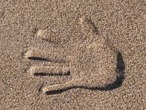 Sand. Hand print in the sand on the beach Stock Images
