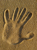Sand Hand Stamp Stock Photo