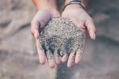 Sand an Hand stockfotos