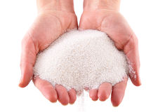 A sand in the hands. Isolated on a white background Royalty Free Stock Photos