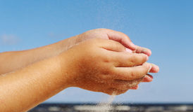 Sand in the hands. Royalty Free Stock Photography