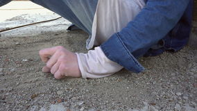 Sand in the hands of men stock video footage