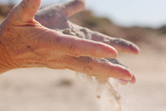 Sand in hands Stock Image