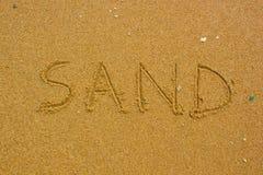 Sand handwritten on the beach Stock Photos