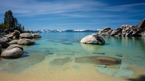 Sand Harbor Lake Tahoe Long exposure blue sky. Long exposure of Sand Harbor at Lake Tahoe North, Nevada county, California, USA, featuring blue transparent water royalty free stock photos