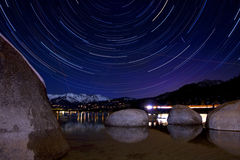 Sand Harbor, Lake Tahoe Star Trails. A 2-hour star trail photo taken at Sand Harbor, Lake Tahoe Stock Photography