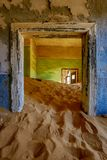 Sand has invaded and taken over these rooms in Kolmanskoppe. Namibia royalty free stock image