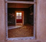 Sand has invaded and taken over these rooms in Kolmanskoppe. Namibia stock image